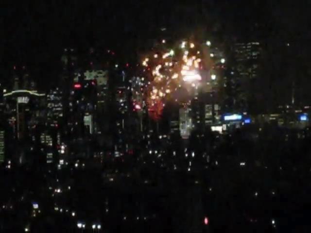 東京ミッドタウンから眺める「神宮外苑花火大会」